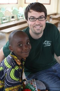 Doug and his sponsor child, Mardoche