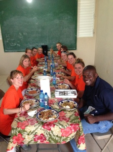 Team happy to be sitting down for first meal in Cap after long day of travel. With Kelly Joseph, one of our translators