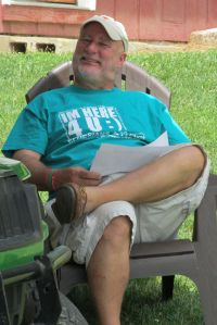 Ken relaxes for a moment after many hours of preparing for camp!